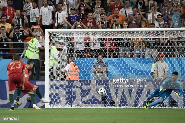 Iran's goalkeeper Alireza Beiranvand saves Portugal's forward Cristiano Ronaldo's penalty during the Russia 2018 World Cup Group B football match...