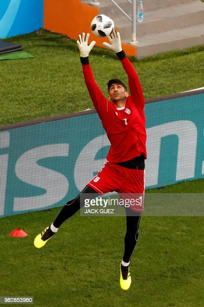 Iran's goalkeeper Alireza Beiranvand takes part in a training session at the Mordovia Arena in Saransk on June 24 on the eve of their Russia 2018...