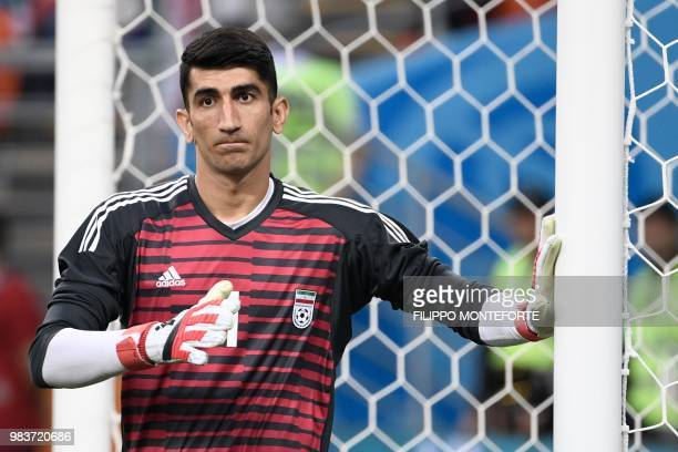 Iran's goalkeeper Alireza Beiranvand warms up prior to the Russia 2018 World Cup Group B football match between Iran and Portugal at the Mordovia...