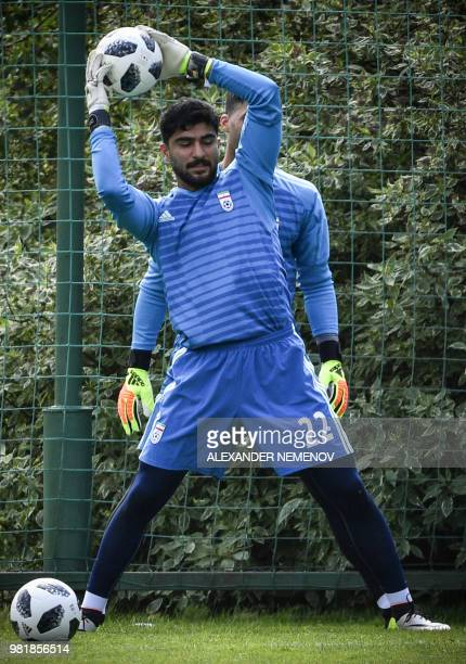 Iran's goalkeeper Amir Abedzadeh does goalkeepers exercices during a training session in Bakovka outside Moscow on June 23 ahead of the 2018 World...