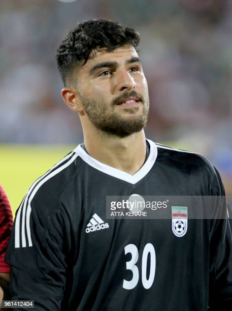Iran's goalkeeper Amir Abedzadeh listens to his national anthem prior to the international friendly football match between Iran and Uzbekistan at...