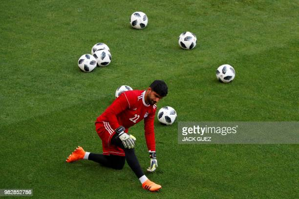 Iran's goalkeeper Amir Abedzadeh takes part in a training session at the Mordovia Arena in Saransk on June 24 on the eve of their Russia 2018 World...