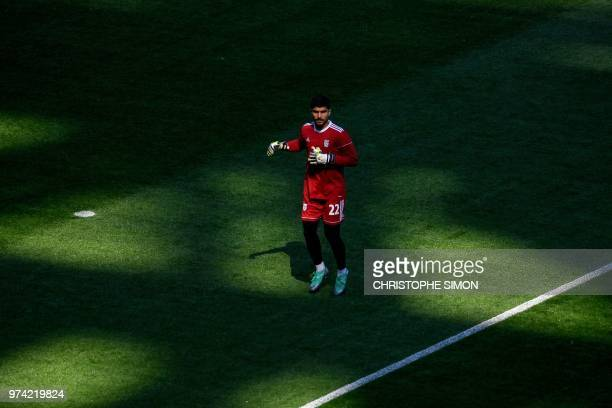 Iran's goalkeeper Amir Abedzadeh warms up prior to take part in a training session of the Iranian national football team at the Saint Petersburg...