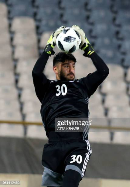 Iran's goalkeeper Amir Abedzadeh warms up prior to the international friendly football match between Iran and Uzbekistan at Tehran's Azadi Stadium on...