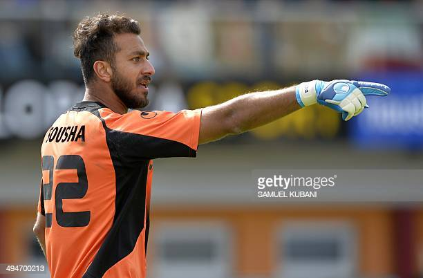 Iran's goalkeeper Sosha Makani gestures during the friendly football match Iran vs Angola in preparation for the FIFA World Cup 2014 on May 30 2014...