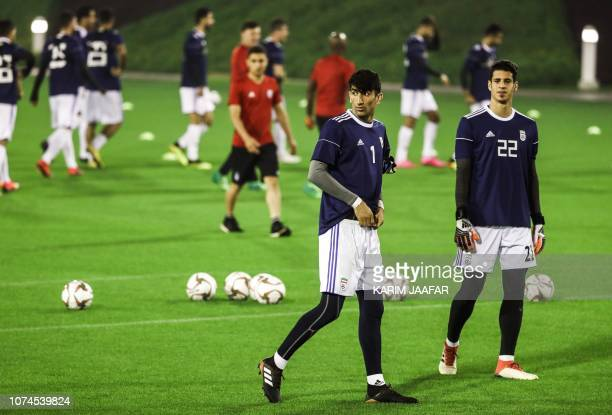 Iran's goalkeepers Payam Niazmand and Alireza Beiranvand attend a training session as the team prepares for the 2019 edition of the AFC Asian cup in...