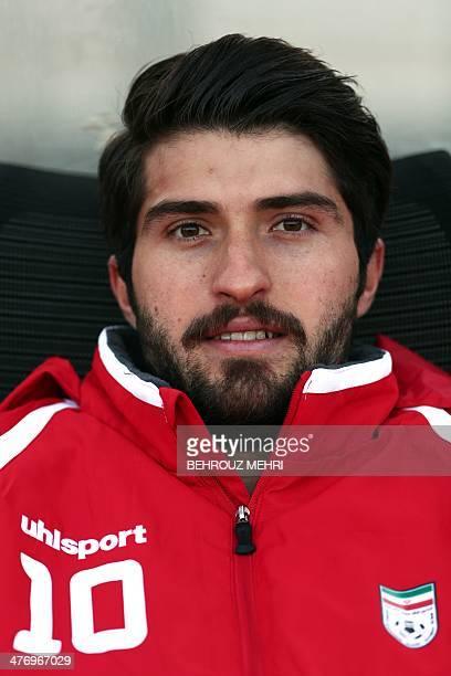 Iran's Karim Ansarifard of Iran's Tractor Sazi club sits on the bench before the international friendly football match Guinea versus Iran at the...