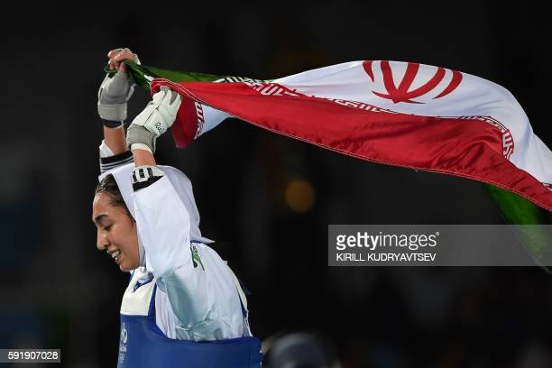 TOPSHOT Iran's Kimia Alizadeh Zenoorin celebrates after winning against Sweden's Nikita Glasnovic in their womens taekwondo bronze medal bout in the...
