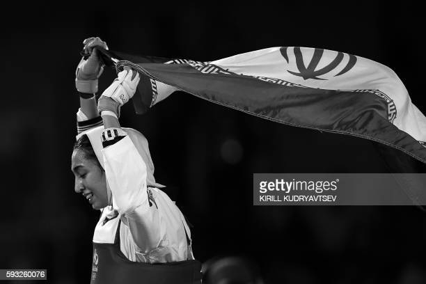 Iran's Kimia Alizadeh Zenoorin celebrates after winning against Sweden's Nikita Glasnovic in their womens taekwondo bronze medal bout in the 57kg...