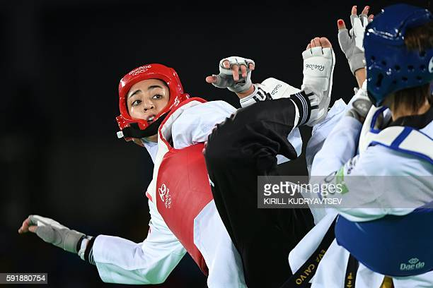 Iran's Kimia Alizadeh Zenoorin competes against Spain's Eva Calvo Gomez during their womens taekwondo quarterfinal bout in the 57kg category as part...