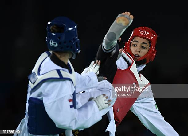 Iran's Kimia Alizadeh Zenoorin competes with Croatia's Ana Zaninovic during their womens taekwondo qualifying bout in the 57kg category as part of...
