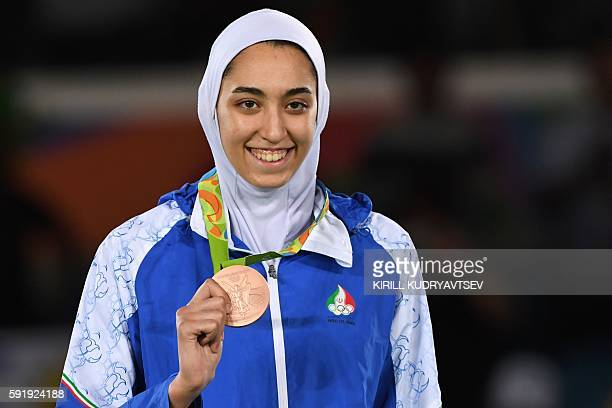 Iran's Kimia Alizadeh Zenoorin poses with her bronze medal on the podium after the womens taekwondo event in the 57kg category as part of the Rio...