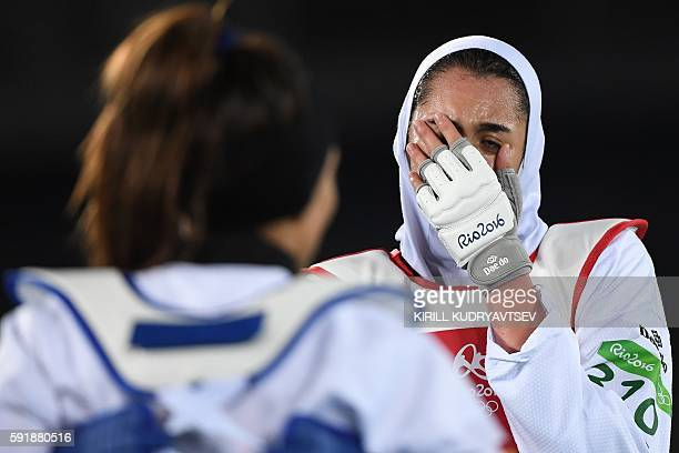 Iran's Kimia Alizadeh Zenoorin reacts after losing to Spain's Eva Calvo Gomez in their womens taekwondo quarterfinal bout in the 57kg category as...