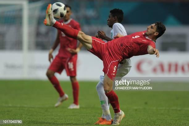 Iran's Mehdikhani Mohammadmehdi controls the ball against Saudi Arabia during the men's football Group F match between Iran and Saudi Arabia at the...