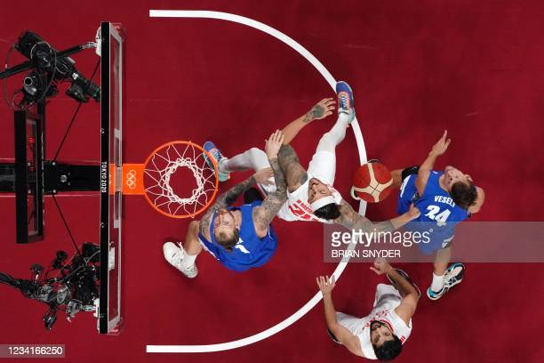 Iran's Michael Rostampour and Czech Republic's Patrik Auda fight for the rebound in the men's preliminary round group A basketball match between Iran...