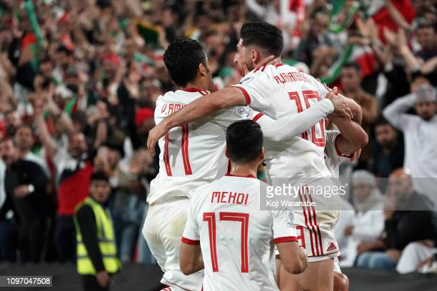 Iran's midfielder Alireza Jahanbakhsh celebrates his opening goal during the AFC Asian Cup round of 16 match between Iran and Oman at Mohammed Bin...