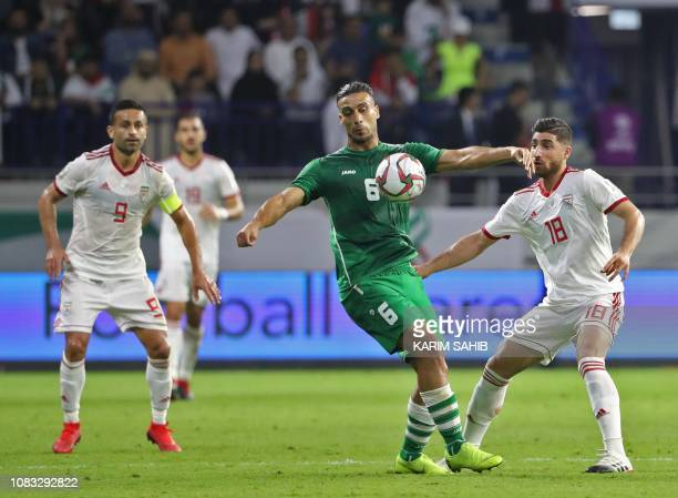 Iran's midfielder Alireza Jahanbakhsh fights for the ball against Iraq's defender Ali Adnan during the 2019 AFC Asian Cup group D football match...