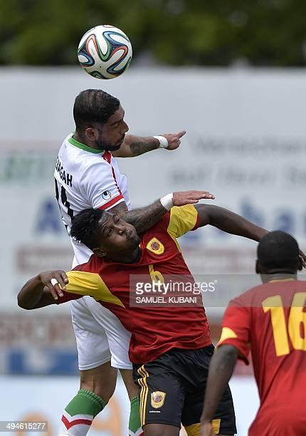 Iran's midfielder Ashkan Dejagah and Angola's midfielder Joaquim Adao vie for the ball during the friendly football match Iran vs Angola in...