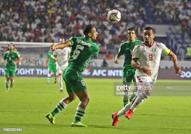 Iran's midfielder Omid Ebrahimi fights for the ball against Iraq's defender Ali Adnan during the 2019 AFC Asian Cup group D football match between...