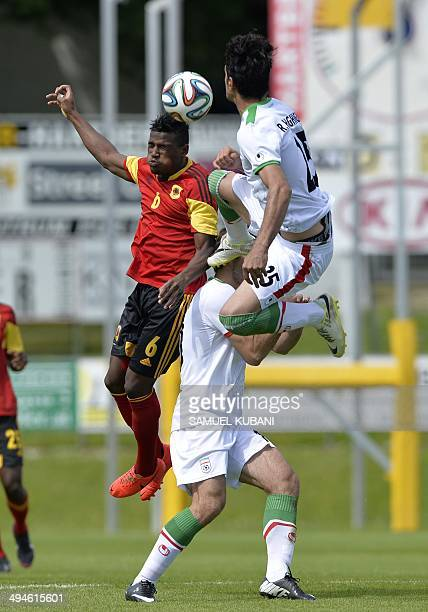 Iran's midfielder Reza Haghighi with Iran's midfielder Karim Ansarifard and Angola's midfielder Joaquim Adao vie for the ball during the friendly...
