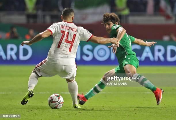 Iran's midfielder Saman Ghoddos fights for the ball with Iraq's midfielder Safaa Hadi AlFuraiji during the 2019 AFC Asian Cup group D football match...