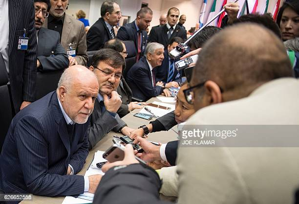 Iran's Minister of Petroleum Bijan Zangeneh talks with journalists as he attends a meeting of the Organization of the Petroleum Exporting Countries...