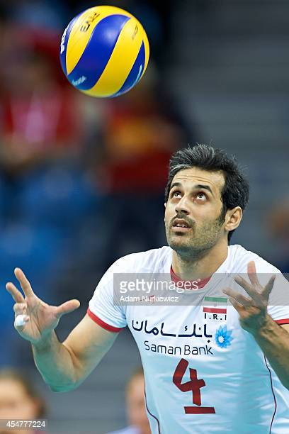 Iran's Mir Saeid Marouflakrani serves the ball during the FIVB World Championships match between Belgium and Iran at Cracow Arena on September 6,...