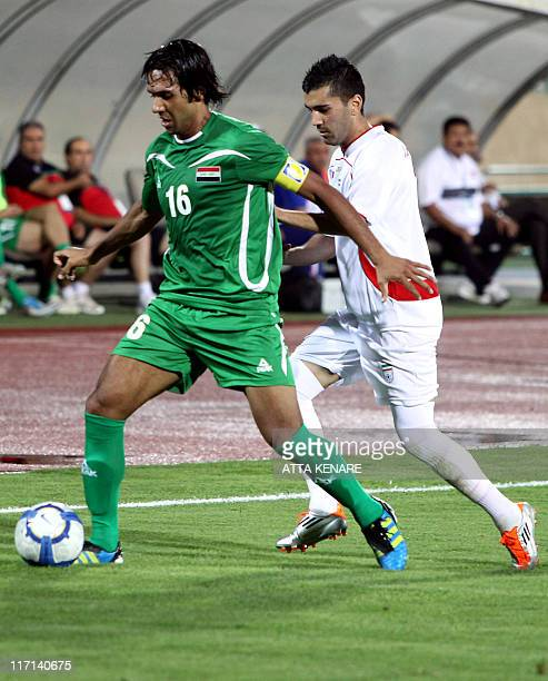 Iran's Mohsen Mosalaman challenges Muthana Khalid Saleh of Iraq during their 2012 Olympic qualifier football match in Tehran on June 23 2011 AFP...