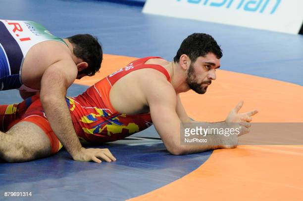 Irans Mojitaba Goleij competes with Romanias Vasile Caras during the Senior U23 Wrestling World Championships in the 97 kg class on November 26 2017...
