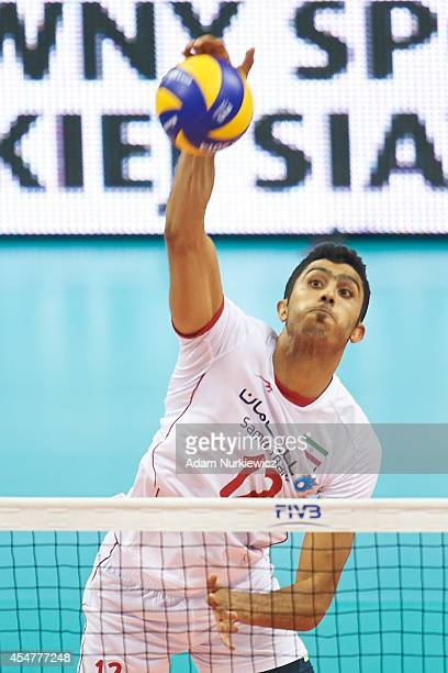 Iran's Mojtaba Mirzajanpour M. Spikes the ball during the FIVB World Championships match between Belgium and Iran at Cracow Arena on September 6,...