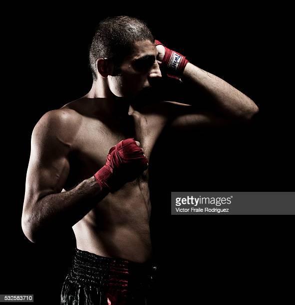 Iran's Muay Thai Kickboxing fighter Farnam Mirsai 'Farre' poses at Sangmorakot gymnasium in Bangkok Thailand Muay Thai also know as 'Art of Eight...