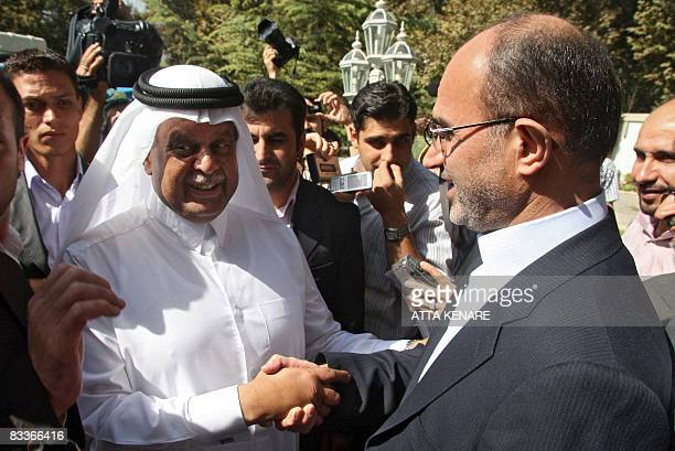 Iran's Oil Minister Gholam Hossein Nozari welcomes Qatar's Minister of Energy and Industry Abdullah bin Hamad alAttiyah prior to a meeting with Alexi...