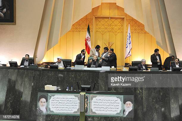 Iran's parliament speaker Ali Larijani seen talking to MPs during an ongoing debate on the floor of Iranian parliament on November 6 2012 in Tehran...