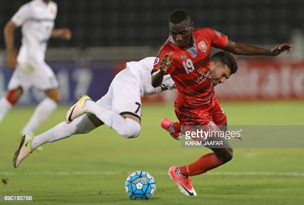Iran's Persepolis FC midfielder Mohsen Mosalman and Qatar's Lekhwiya forward Ali alMoez vie for the ball during the AFC Champions League football...
