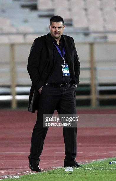 Iran's Persepolis head coach Ali Daei attends his team's 2011 AFC Champions League group C football match against United Arab Emirate's AlWahda club...