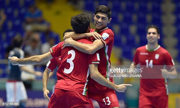 Iran's player Ahmad Esmaeilpour celebrates with teammates his goal against Paraguay during their Colombia 2016 FIFA Futsal World Cup quaterfinal...
