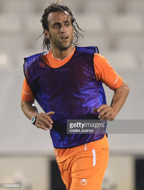 Iran's player Ali Karimi attends a training session in September 5 in Doha Iran will play against Qatar in the third round of Asian qualifying for...