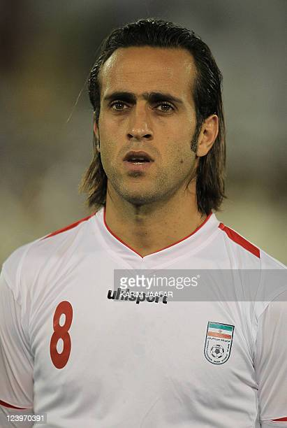 Iran's player Ali Karimi poses during their 2014 World Cup Asian zone qualifying football match against Qatar at the AlSadd stadium in Doha on...