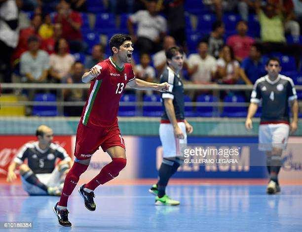 Iran's player Farhad Tavakoli celebrates a goal scored by his teammate Ahmad Esmaeilpour against Paraguay during their Colombia 2016 FIFA Futsal...