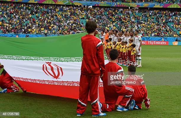 Iran's players line up to sing their national anthem before a Group F football match between BosniaHercegovina and Iran at the Fonte Nova Arena in...