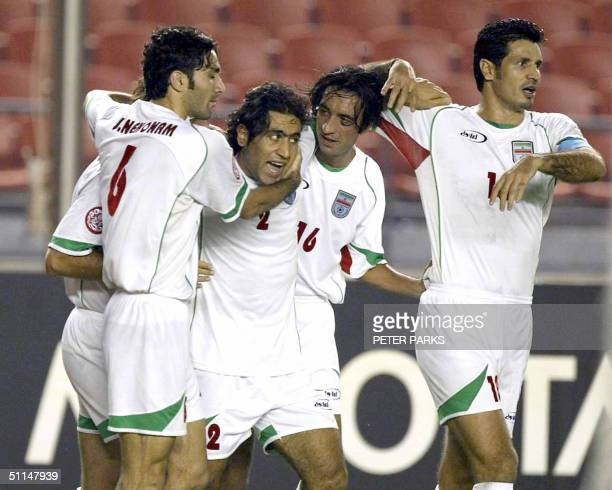 Iran's players mob Mehdi Mahdavikia for setting up the second goal scored by teammate Ali Karimi during the Asian Cup thirdplacing match 06 August...