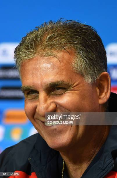 Iran's Portugese coach Carlos Queiroz smiles during a press conference at the Fonte Nova Arena in Salvador on June 24 on the eve of their 2014 FIFA...