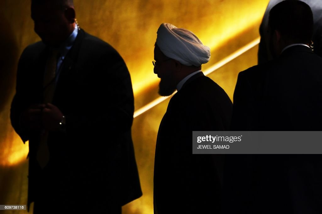 TOPSHOT - Iran's President Hassan Rouhani (C) leaves after addressing the 71st session of the United Nations General Assembly at the UN headquarters in New York on September 22, 2016. / AFP PHOTO / Jewel SAMAD
