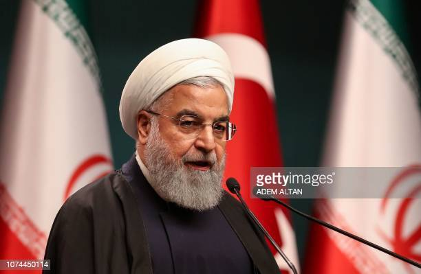 Iran's President Hassan Rouhani speaks during a joint press conference with the Turkish President at the Turkish presidential complex in Ankara on...