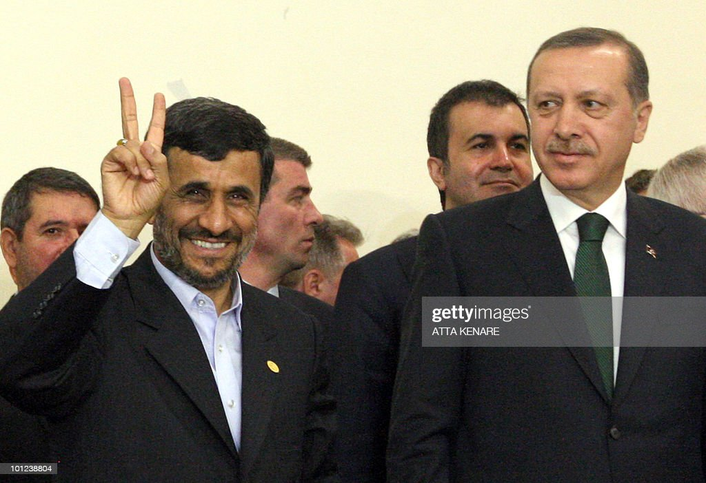 Iran's President Mahmoud Ahmadinejad flashes the V-sign for victory as Turkish Prime Minister Recep Tayyip Erdogan looks on after the Islamic republic inked a nuclear fuel swap deal in Tehran on May 17, 2010 under which 1,200 kilos of low enriched uranium will be shipped to Turkey, potentially ending a standoff with world powers gearing for new sanctions against Tehran. The agreement, under which Iran will in turn receive nuclear fuel for a Tehran reactor, was signed in the Iranian capital by the foreign ministers of Iran, Brazil and Turkey.