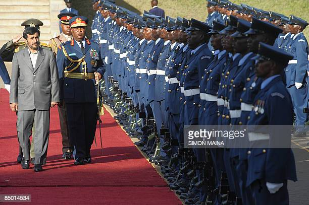 Iran's President Mahmoud Ahmadinejad inspects a guard of honour mounted by the Kenya Airforce 24 February 2009 after he arrived in the capital...