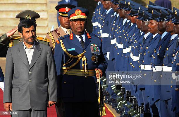 Iran's President Mahmoud Ahmadinejad inspects a guard of honour mounted by the Kenya Airforce on February 24 2009 upon his arival in the capital...