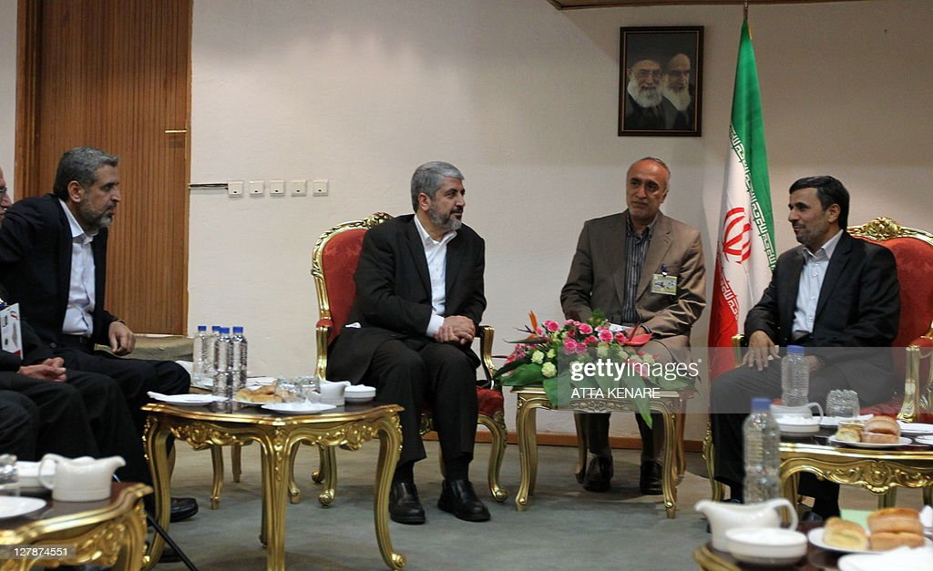 Iran's President Mahmoud Ahmadinejad (R) : News Photo