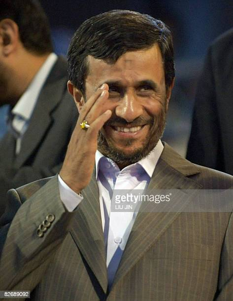 Iran's President Mahmoud Ahmadinejad waves as he arrives for the opening ceremony of the 2008 Beijing Paralympic Games at the National Stadium also...