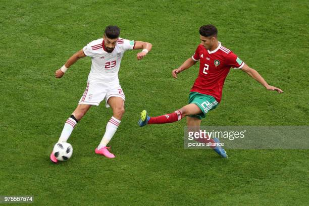 Iran's Ramin Rezaeian and Morocco's Achraf Hakimi vie for the ball during the FIFA World Cup 2018 Group B soccer match between Iran and Morocco at...